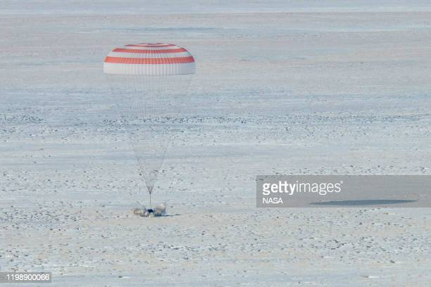 In this handout image supplied by NASA, The Soyuz MS-13 spacecraft is seen as it lands in a remote area near the town of Zhezkazgan, Kazakhstan with...