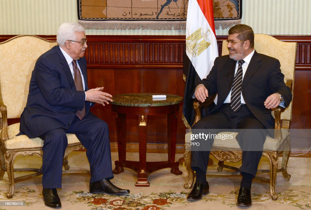 In this handout image supplied by PPO, Palestinian President Mahmoud Abbas attends a meeting with Egyptian President Mohamed Morsi, on February 5, 2013 in Cairo, Egypt. Protests have continued across Egypt nearly more than one week after the second anniversary of the Egyptian Revolution that overthrew former President Hosni Mubarak.