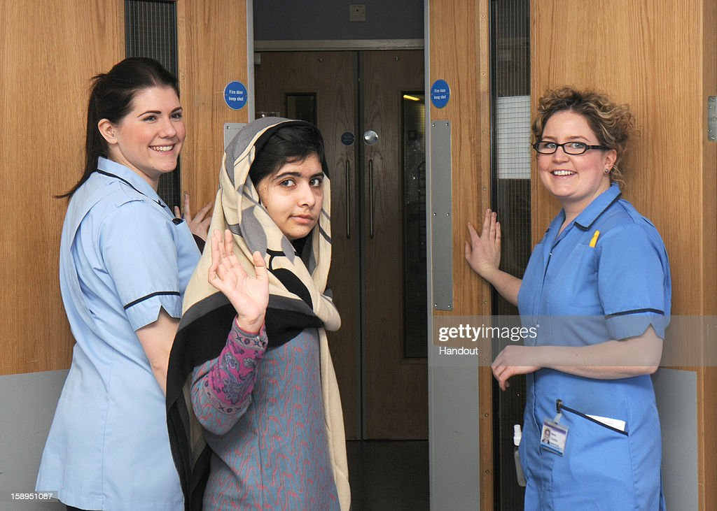 In this handout image supplied by Queen Elizabeth Hospital on January 04, 2013 Malala Yousafzai leaves the Queen Elizabeth Hospital in Birmingham, United Kingdom. The Pakistani schoolgirl activist who was shot in the head by Taliban gunmen has been discharged today from Queen Elizabeth Hospital in Birmingham as an inpatient.