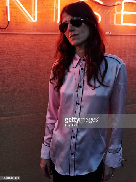 In this handout image supplied by RayBan Bella Freud wearing RayBan poses at the RayBan Studios during All Points East Festival at Victoria Park on...