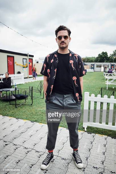 In this handout image supplied by RayBan Ben Aldridge wearing RayBan poses at the RayBan Studios during All Points East Festival at Victoria Park on...