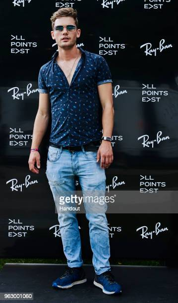 In this handout image supplied by RayBan Jeremy Irvine wearing RayBan poses at the RayBan Studios during All Points East Festival at Victoria Park on...