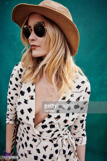 In this handout image supplied by Ray-Ban, Laura Whitmore wearing Ray-Ban poses at the Ray-Ban Studios at All Points East Festival at Victoria Park...