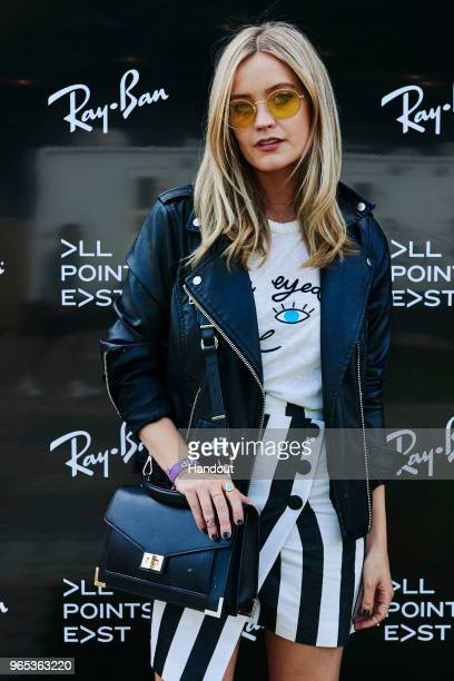 In this handout image supplied by RayBan Laura Whitmore wearing RayBan poses at the RayBan Studios during All Points East Festival at Victoria Park...