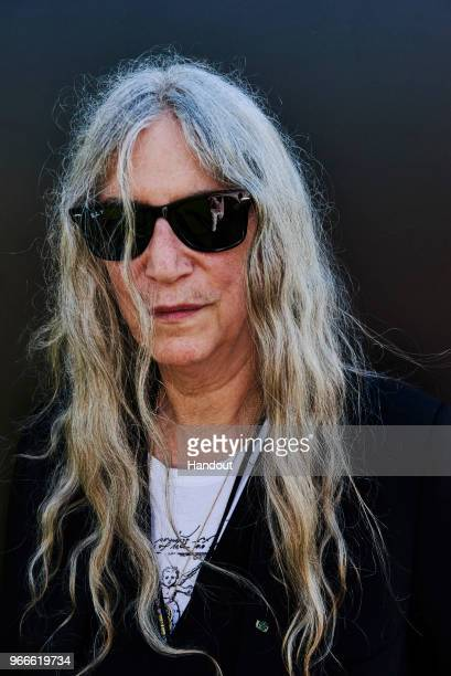 In this handout image supplied by RayBan Patti Smith wearing RayBan poses at the RayBan Studios during All Points East Festival at Victoria Park on...