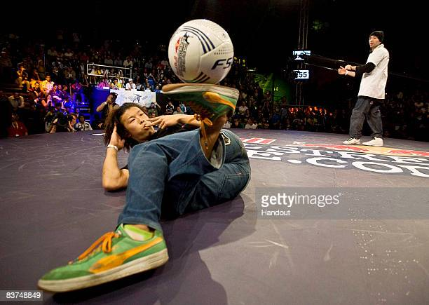 In this handout image supplied by Red Bull Yosuke Yokota of Japan in action against Arnaud Garnier of France during the final oneonone battle in the...