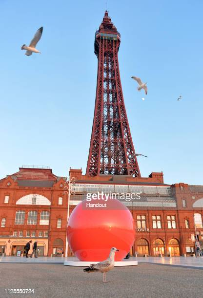 In this handout image supplied by Sainsburys/ Comic Relief, a giant red nose has popped up outside the Blackpool Tower as Sainsbury's celebrates its...