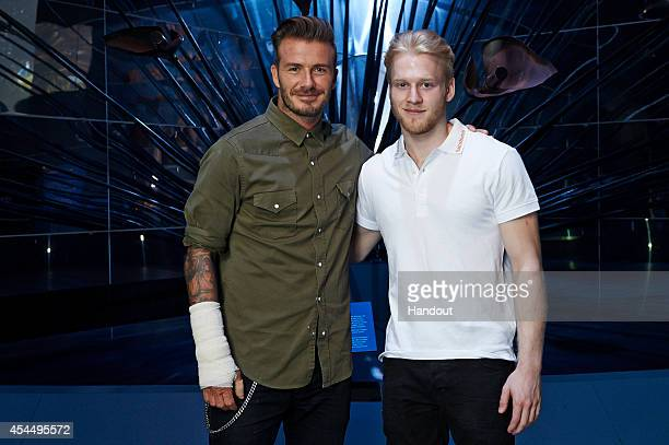 In this handout image supplied by Sainsbury's Sainsbury's Active Kids ambassadors David Beckham and Jonnie Peacock hold a special motivational...
