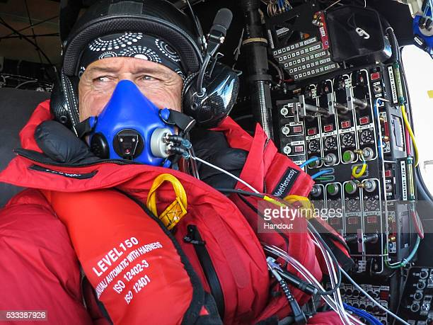 In this handout image supplied by SI2 A selfie image by Swiss adventurer Andre Borschberg onboard Solar Impulse 2 during the flight from Tusla/OK to...