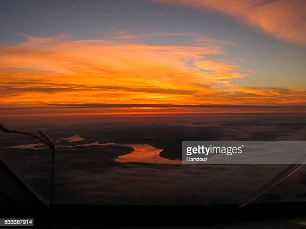 In this handout image supplied by SI2 An image by Swiss adventurer Andre Borschberg onboard Solar Impulse 2 during the flight from Tusla/OK to...