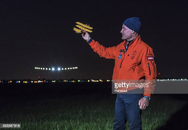 In this handout image supplied by SI2 Bertrand Piccard welcoming Solar Impulse 2 piloted by Swiss adventurer Andre Borschberg at Dayton International...