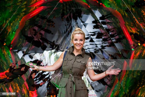 In this handout image supplied by Spark Your City TV Presenter Helen Skelton interacts with visitors at the 'Spark Your City Urban Jungle' giant...