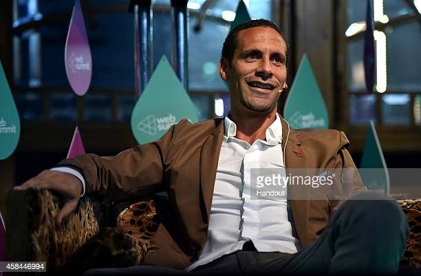 In this handout image supplied by Sportsfile, Rio Ferdinand, QPR footballer and Ambassador, BT Sport, speaks on stage during Day 2 of the 2014 Web...