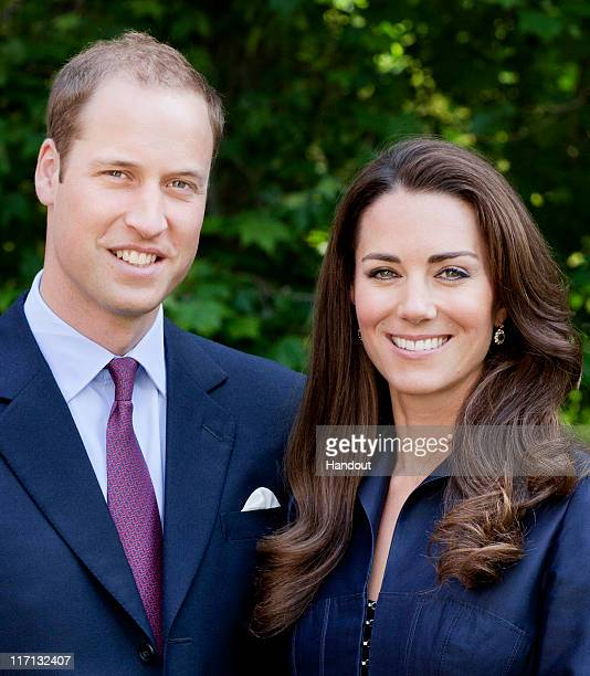 In this handout image supplied by St James's Palace Prince William Duke of Cambridge and Catherine Duchess of Cambridge pose for the official tour...