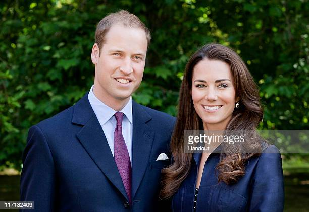 In this handout image supplied by St James's Palace, Prince William, Duke of Cambridge and Catherine, Duchess of Cambridge pose for the official tour...