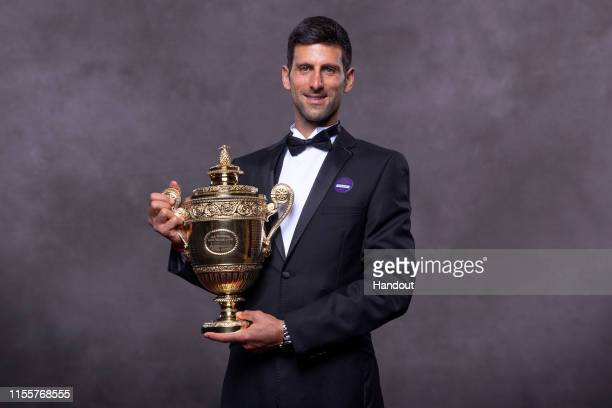 In this handout image supplied by the All England Lawn Tennis Club, Novak Djokovic of Serbia, the Gentlemens Singles champion photographed at the...