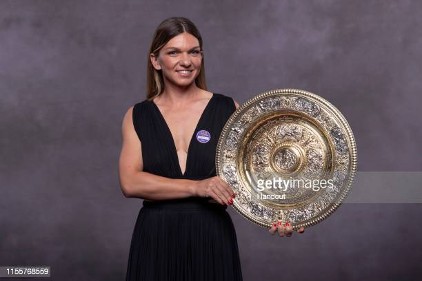 In this handout image supplied by the All England Lawn Tennis Club, Simona Halep of Romania, the Ladies Singles champion photographed at the...