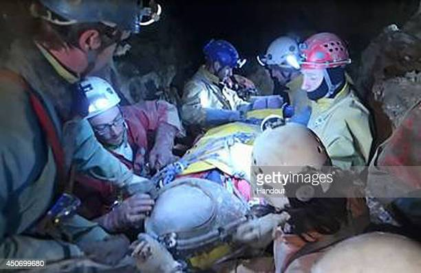 In this handout image supplied by the Bavarian mountain patrol 'Bergwacht Bayern' Rescue workers transport injured spelunker Johann Westhauser from...