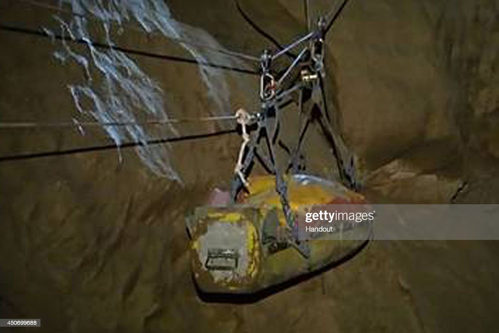In this handout image supplied by the Bavarian mountain patrol 'Bergwacht Bayern', Injured spelunker Johann Westhauser is transported with ropes by rescue workers from 700 meters underground towards the surface of the Riesending cave on June 16, 2014 near Marktschellenberg, Germany. Westhauser, along with two colleagues, was exploring the Riesending vertical cave, which is over 20km long and up to 1,148 meters deep, when he was struck by rocks and severely injured 1,000 meters underground on June 8. Since then specialist rescue workers from across Europe are helping with the arduous rescue effort, which will likely take at least several more days.