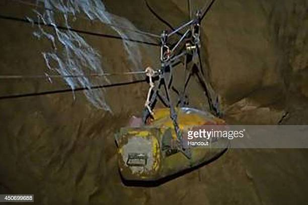 In this handout image supplied by the Bavarian mountain patrol 'Bergwacht Bayern' Injured spelunker Johann Westhauser is transported with ropes by...