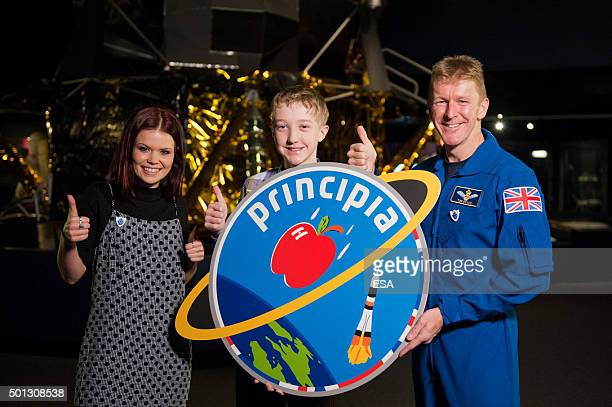 In this handout image supplied by the European Space Agency BBC presenter Lindsay Russel 13yearold logo designer Troy and ESA astronaut Tim Peake...