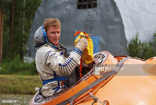 In this handout image supplied by the European Space Agency ESA astronaut Timothy Peake takes part in a water survival training session on July 2...
