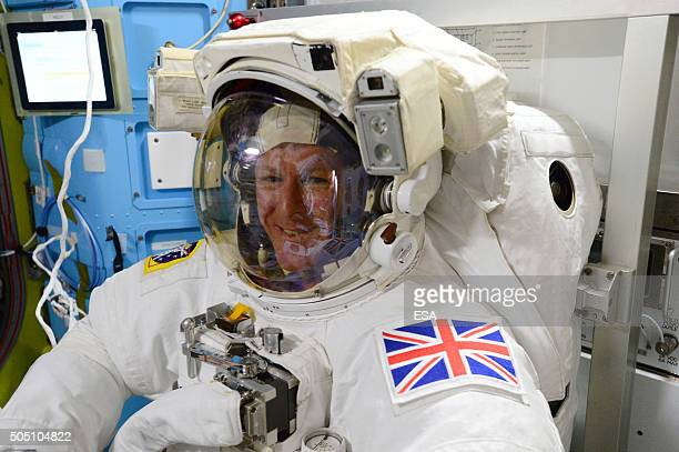 In this handout image supplied by the European Space Agency ESA astronaut Tim Peake during the final fit check of his spacesuit ahead of the...