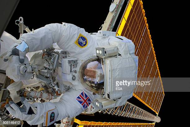 In this handout image supplied by the European Space Agency ESA astronaut Tim Peake takes part in his 4 hour 43 minute spacewalk to replace a failed...
