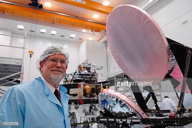 In this handout image supplied by the European Space Agency Astrophysicist Professor George F Smoot Nobel Prize winner in Physics 2006 poses in front...