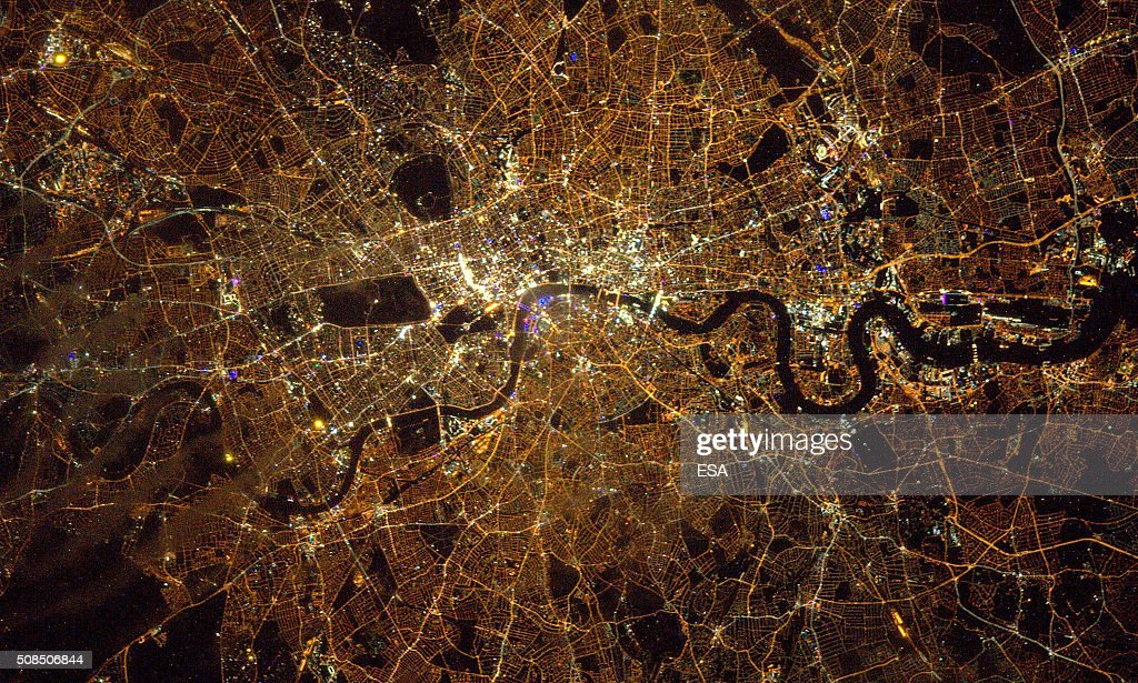 In this handout image supplied by the European Space Agency (ESA), The ISS passes over London, in an image taken by British ESA astronaut Tim Peake from the Space Station's Cupola observatory, 400 km above Earth, January 30, 2016. The lights in the image are mainly street lighting, illuminating the streets of London. Lights appearing blue are LED-lit areas. Black areas in the picture correspond to unlit areas such as parks and rivers - the distinctive wind of the River Thames shows in black. Hyde Park, Regents Park and Battersea Park are recognisable in the centre, the reservoirs at Walthamstow are upper centre, and Richmond Park is at lower left. Tim Peake's six-month mission to the International Space Station is named Principia, after Isaac Newton's ground-breaking Naturalis Principia Mathematica, which describes the principal laws of motion and gravity.