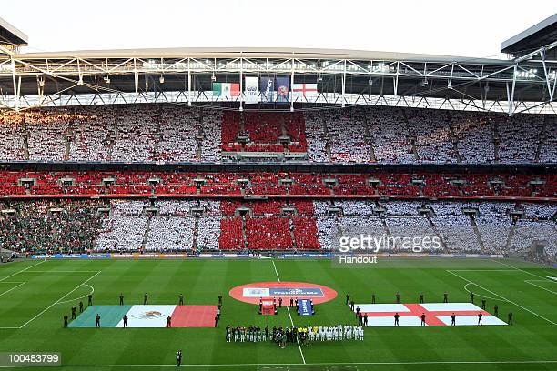 In this handout image supplied by the FA England fans attempt a spectacular and World Record breaking show of support by creating the biggest ever St...