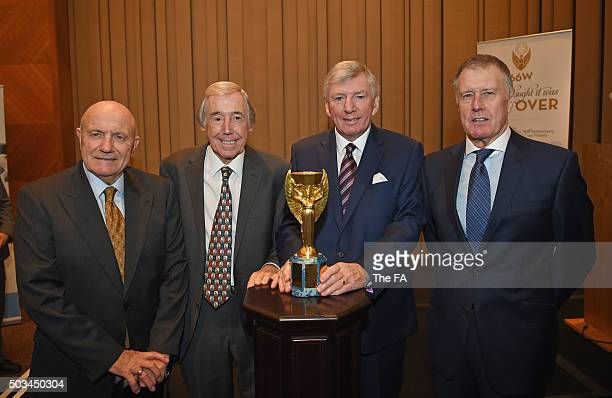 In this handout image supplied by The FA, George Cohen, Gordon Banks, Martin Peters and Sir Geoff Hurst pose with a replica of the Jules Rimet Trophy...