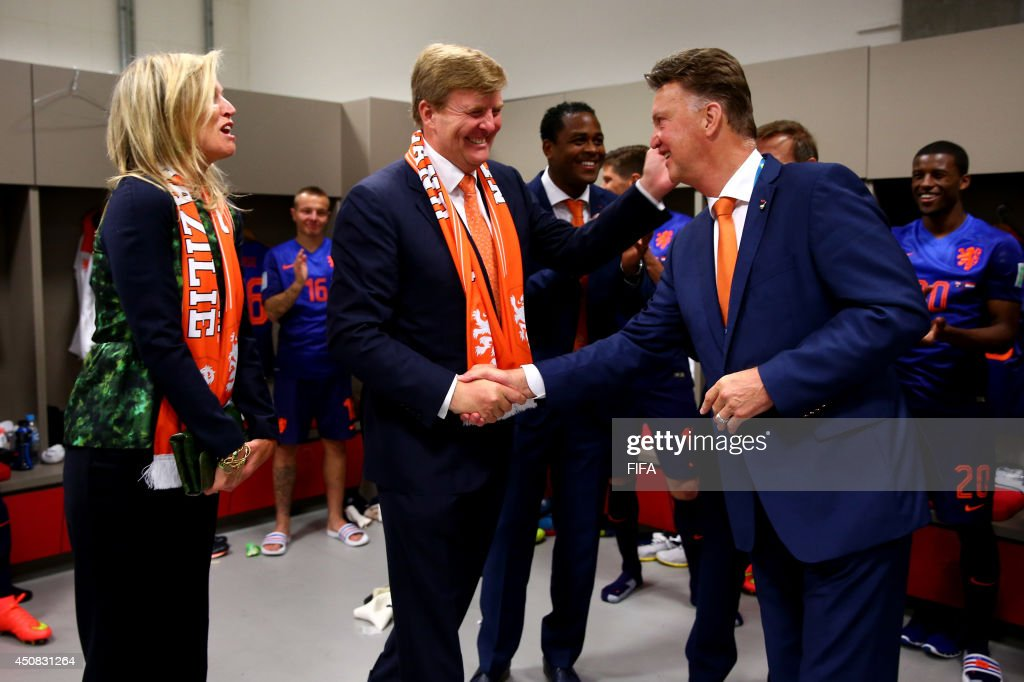 In this handout image supplied by the FA, King Willem-Alexander of the Netherlands and Queen Maxima of the Netherlands celebrate with coach Louis van Gaal of the Netherlands after the 2014 FIFA World Cup Brazil Group B match between Australia and Netherlands at Estadio Beira-Rio on June 18, 2014 in Porto Alegre, Brazil.