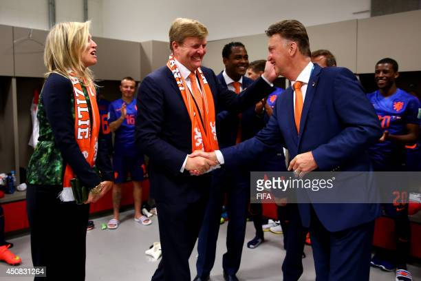In this handout image supplied by the FA, King Willem-Alexander of the Netherlands and Queen Maxima of the Netherlands celebrate with coach Louis van...