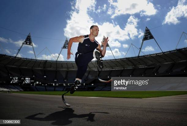 In this handout image supplied by the Fast Track Agency, Athlete Oscar Pistorius of South Africa poses during a photocall at the Olympic Stadium in...