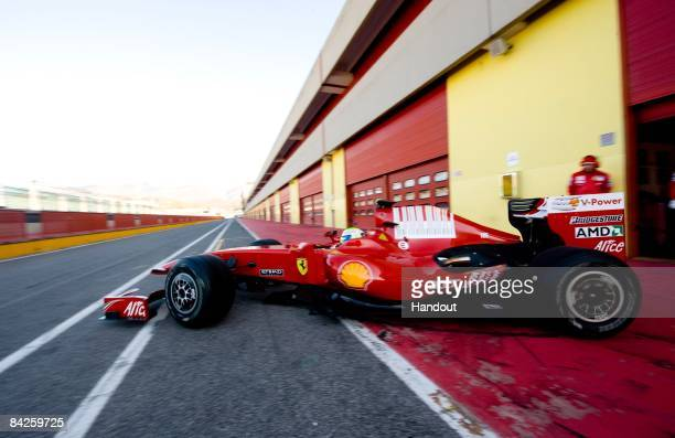 In this handout image supplied by the Ferrari Press Office, Felipe Massa of Brasil leaves the garage to test drive the new Ferrari F60 Formula One...
