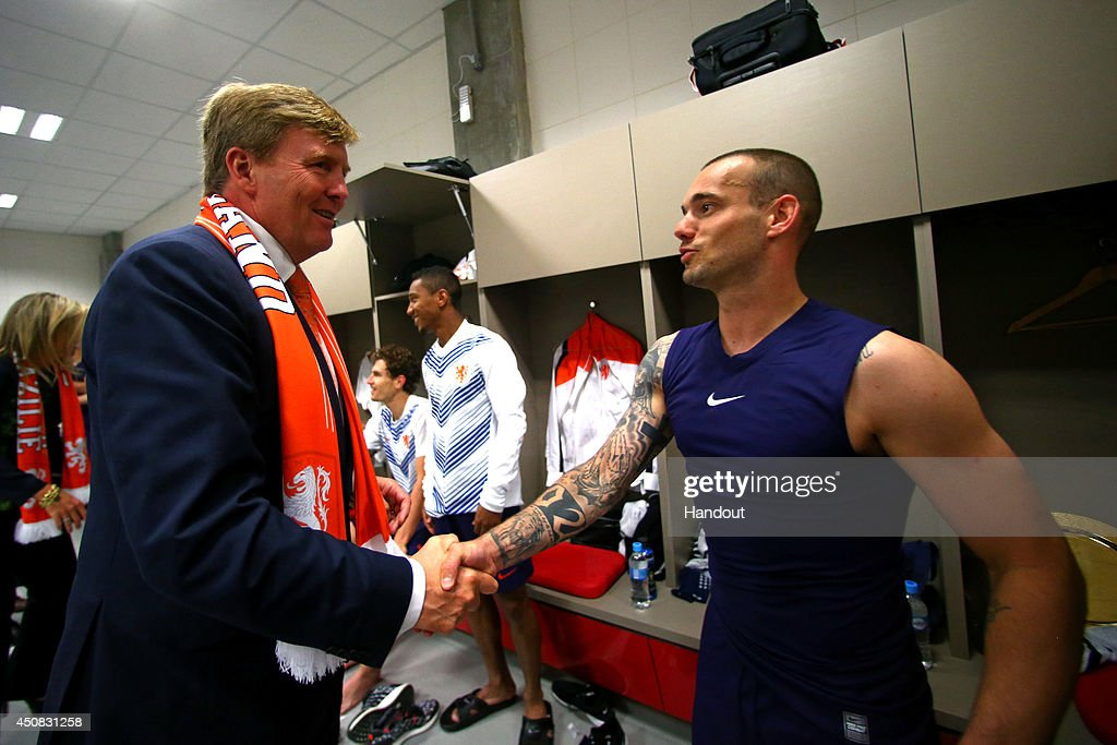 In this handout image supplied by the FIFA, King Willem-Alexander of the Netherlands congratualates Wesley Sneijder of the Netherlands after the 2014 FIFA World Cup Brazil Group B match between Australia and Netherlands at Estadio Beira-Rio on June 18, 2014 in Porto Alegre, Brazil.
