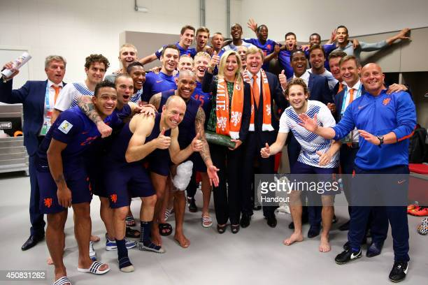 In this handout image supplied by the FIFA King WillemAlexander of the Netherlands and Queen Maxima of the Netherlands celebrate with the Netherlands...