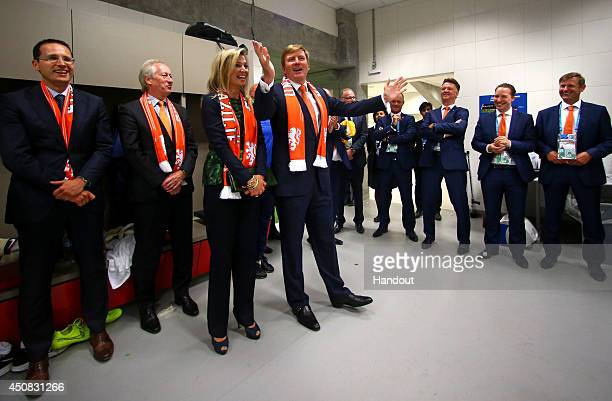 In this handout image supplied by the FIFA, King Willem-Alexander of the Netherlands and Queen Maxima of the Netherlands celebrate with the...