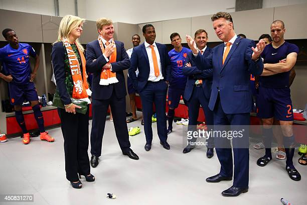 In this handout image supplied by the FIFA King WillemAlexander of the Netherlands and Queen Maxima of the Netherlands celebrate with coach Louis van...