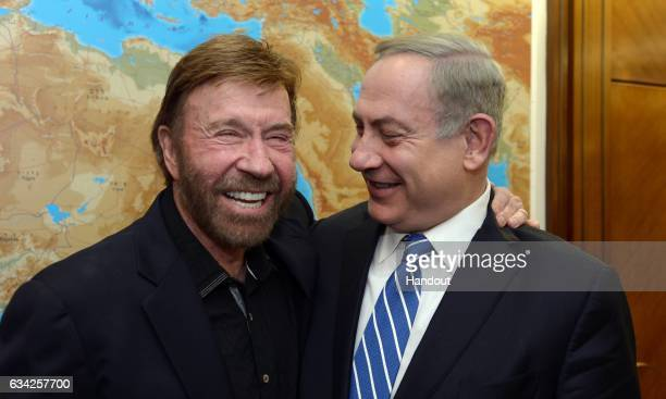 In this handout image supplied by the Government Press Office Israeli Prime Minister Benjamin Netanyahu meets with actor Chuck Norris on February 8...