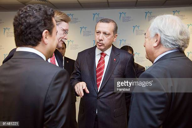 In this handout image supplied by the IMF International Monetary Fund's Turkey's Deputy Prime Minister Ali Babacan World Bank President Robert...
