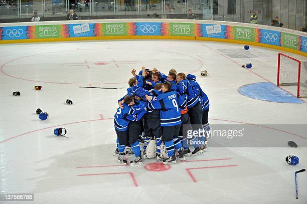 In this handout image supplied by the International Olympic Committee Team Finland celebrates after beating Russia in the Final Game of Men's Ice...