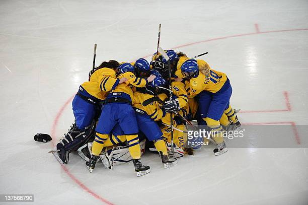 In this handout image supplied by the International Olympic Committee Team Sweden celebrates after winning Women's Ice Hockey Tournament of the...