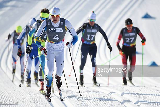 In this handout image supplied by the IOC Adam Persson of Sweden leads the pack in the CrossCountry Skiing Men's Sprint Classic at Birkebeineren...