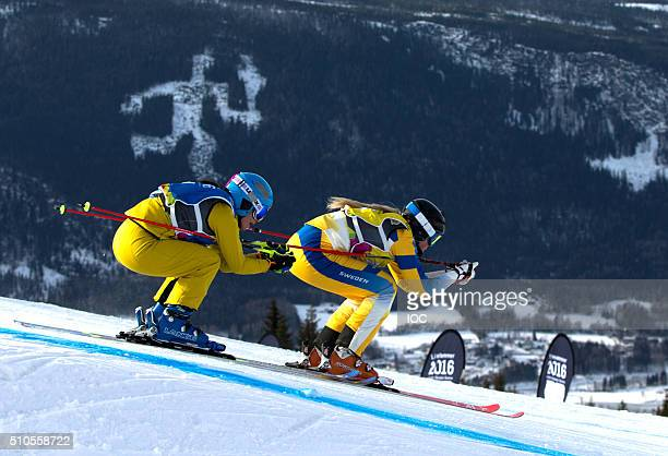 In this handout image supplied by the IOC Celia Funkler of Germany and Veronica Edebo of Sweden compete in Team SkiSnowboard Cross at Hafjell...