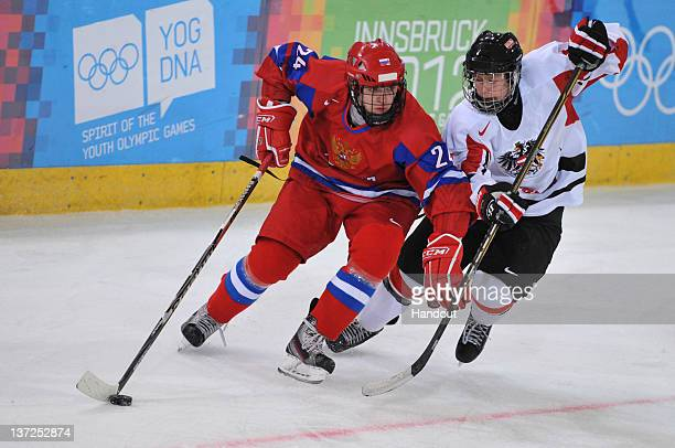 In this handout image supplied by the IOC Egor Svetlakov of Russia competes in the men's Ice Hockey match between Russia and Austria at the...