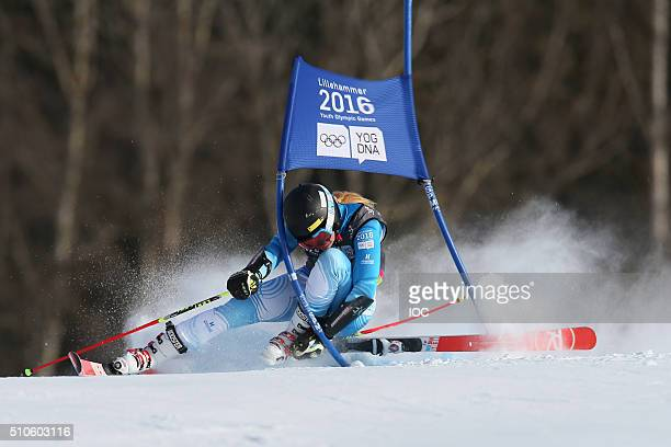 In this handout image supplied by the IOC, Francesca Baruzzi Farriol of Argentina loses her ski and crashes during the Alpine Skiing Ladies Giant...