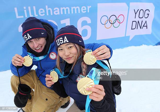In this handout image supplied by the IOC, Jake Pates of United States and Chloe Kim of United States pose with the Gold Medals they won after the...