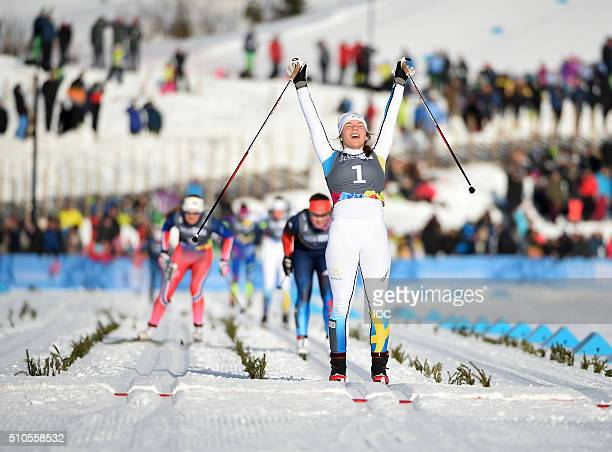 In this handout image supplied by the IOC Johanna Hagstroem of Sweden crosses the finish line to win the gold medal in the CrossCountry Skiing...
